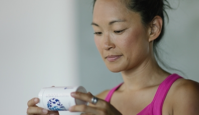 Woman checking supplement label