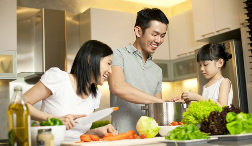 Asian Family spending time together in the kitchen