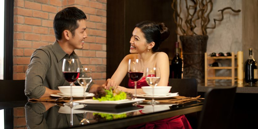 Attractive asian couple having a romantic dinner
