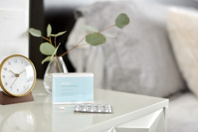 package of oral probiotic on nightstand to be taken before bed