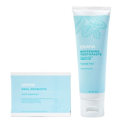 USANA oral probiotic and whitening toothpaste on white background