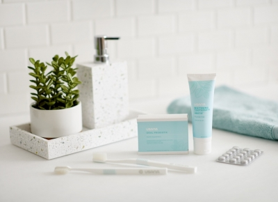 toothpaste and oral probiotic in styled bath setting